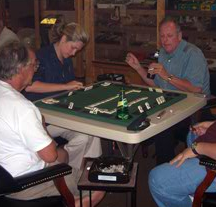 Patrons playing a game of dominos
